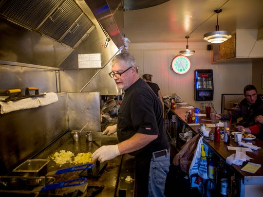 Joe Tucker prepares hash browns at Tucker's Restaurant Wednesday, December 21, 2016 on Vine Street. 