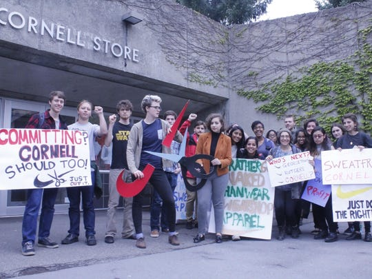 Members of the Cornell Organization for Labor Action protest outside the Cornell Store in May.