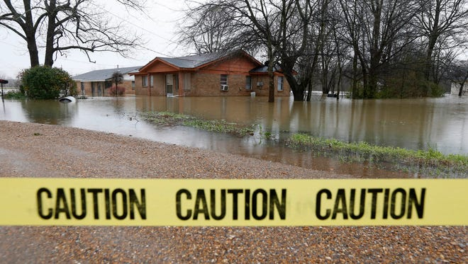Caution tape closes off this neighborhood in Drew, Miss., Friday, March 11, 2016, as floodwaters have affected areas in the Delta. The flooding has affected the Delta to varying degrees. (AP Photo/Rogelio V. Solis)