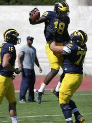 Nick Eubanks and Stephen Spanellis celebrate a play during the Wolverines' last practice in Rome on April 29, 2017.