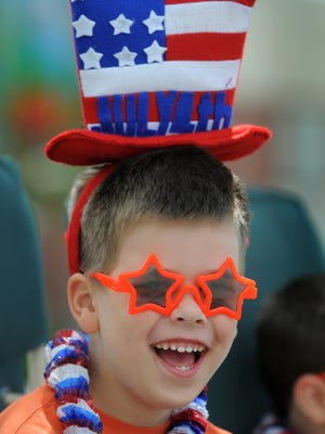 Nathan Ferrell,5, wears his best red, white, and blue as he waits for the star of the 20th Annual Fishers Freedom Parade in Fishers. (Matt Kryger / The Indianapolis Star)
