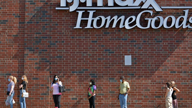 A line forms outside TJ Maxx and Homegoods at the Greendale Mall in Worcester Tuesday.