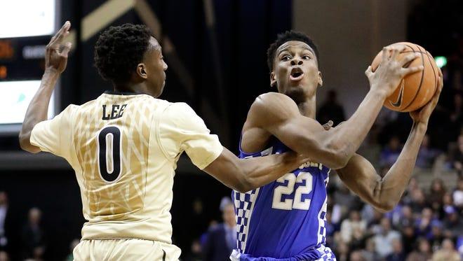 Kentucky guard Shai Gilgeous-Alexander (22) drives against Vanderbilt guard Saben Lee (0) in the first half of an NCAA college basketball game Saturday, Jan. 13, 2018, in Nashville, Tennessee.