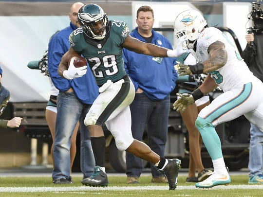 Nov 15, 2015; Philadelphia, PA, USA; Philadelphia Eagles running back DeMarco Murray (29) pushes away Miami Dolphins outside linebacker Koa Misi (55) during the fourth quarter at Lincoln Financial Field. The Dolphins won 20-19.