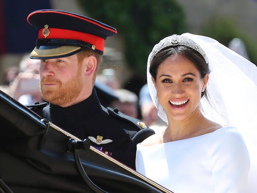 Prince Harry and his wife, the former Meghan Markle, now the Duke and Duchess of Sussex, leave after their wedding ceremony at St. George's Chapel on May 19, 2018, boarding an open carriage for a ride through Windsor before a cheering crowd of about 100,000 people. GARETH FULLER/AP