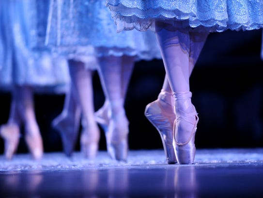 In this 2010 file photo, dancers perform as snow flakes