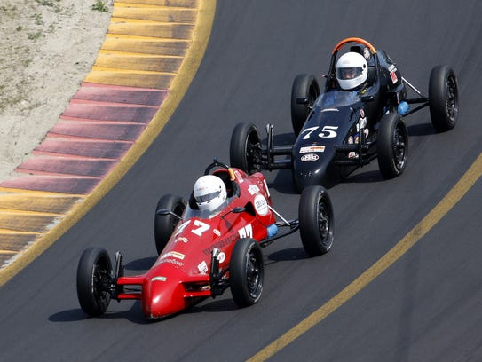 Formula Vee winner Rick Shields steers his car through