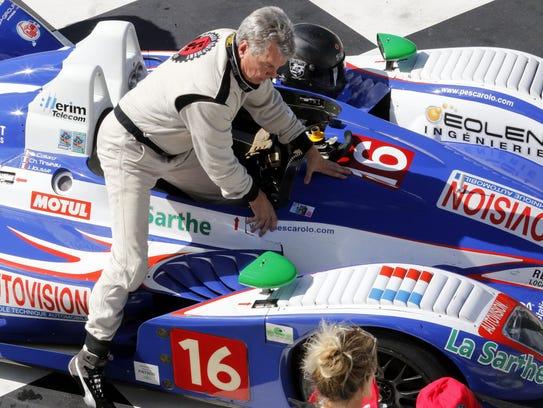 Sports car group rac e winner Randy Johnson climbs