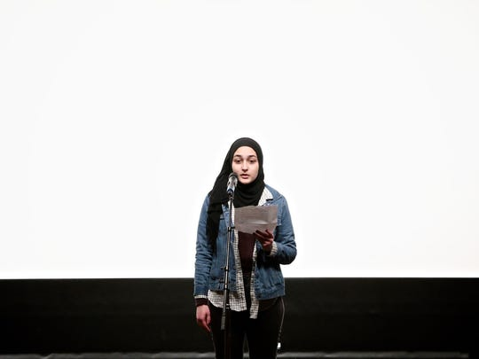 "Hajjar Baban, 17, from Inside Out Literary Art Project, reads poetry before the third annual Freep Film Festival's screening of ""Romeo is Bleeding"" at the DIA on Saturday, April 2, 2016, in Detroit."