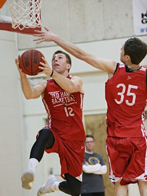 Ty Sabin goes up for a shot past teammate Koy Brecklin during practice.