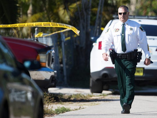 The Lee County Sheriff's Office works the scene of an officer-involved shooting Thursday in the 16000 block of Aura Lane in Bokeelia.