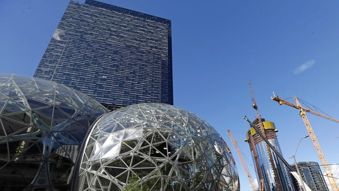 In this Oct. 11, 2017, file photo, large spheres take shape on the Amazon campus in Seattle, Washington. The company had announced that it was looking for a second home to complement its Seattle headquarters, expected to cost more than $5 billion and to house as many as 50,000 employees. Amazon released its list of potential sites Thursday and Detroit isn't on it.