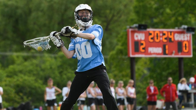 South Burlington goalie Claire Phillips (00) passes the ball down the field during the girls lacrosse game between the South Burlington Wolves and the Champlain Valley Union Redhawks at CVU High School on Wednesday afternoon June 6, 2018 in Hinesburg.