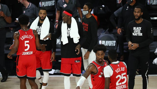 """Toronto forward Pascal Siakam (43) and the Raptors celebrate their series victory over the Brooklyn Nets Sunday night in the Disney World """"bubble."""""""