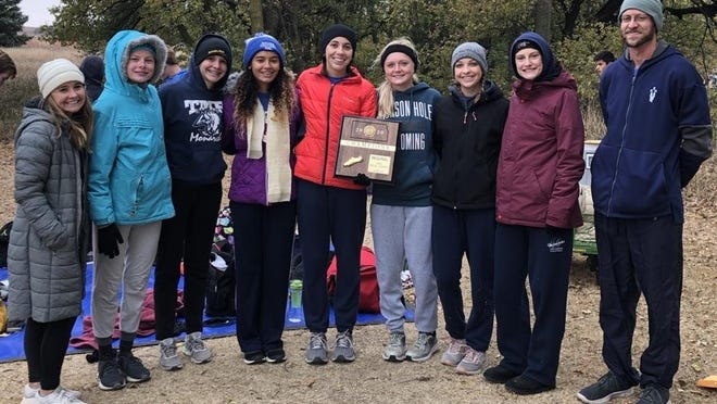 The Thomas More Prep-Marian girls cross country team won a Class 3A regional title at Norton on Saturday.