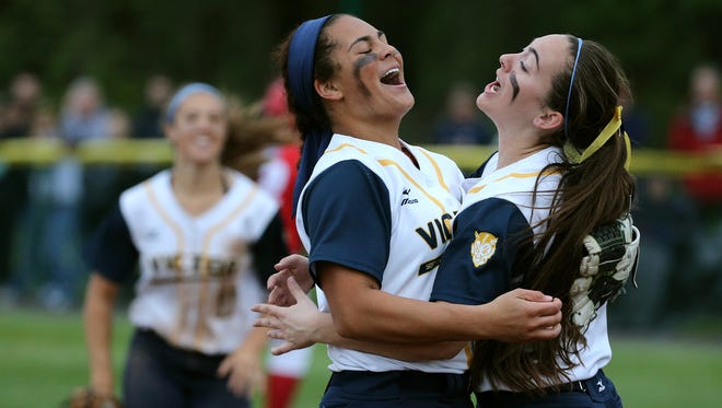 Victor sophomore Erin Wong (blue headband) celebrates with Allison Reed after a 2-0 win over Fairport to win the Class AA title. Wong pitched a two-hitter and Reed had an RBI single.