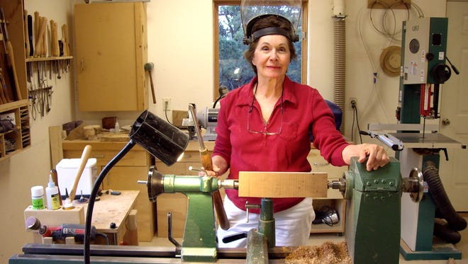 Artist Madeleine Sabo at her wood turning table.