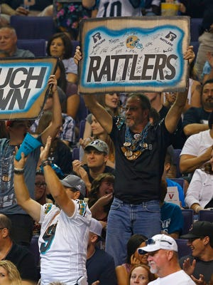 Rattlers' fans celebrate a touchdown against the Storm at Talking Stick Resort Arena on April 16, 2016 in Phoenix, Ariz.