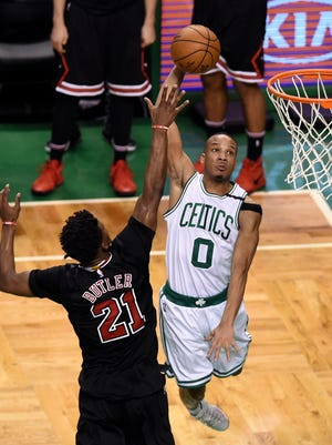Boston Celtics guard Avery Bradley (0) goes to the basket past Chicago Bulls forward Jimmy Butler (21) during the second half in game five of the first round of the 2017 NBA Playoffs.