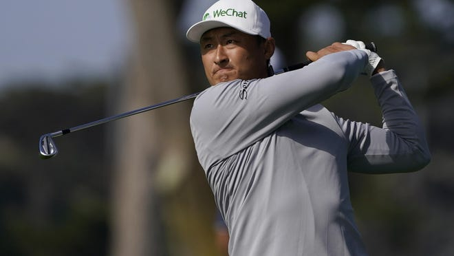 Li Haotong hits from the fairway on the 10th hole during the second round of the PGA Championship on Friday.