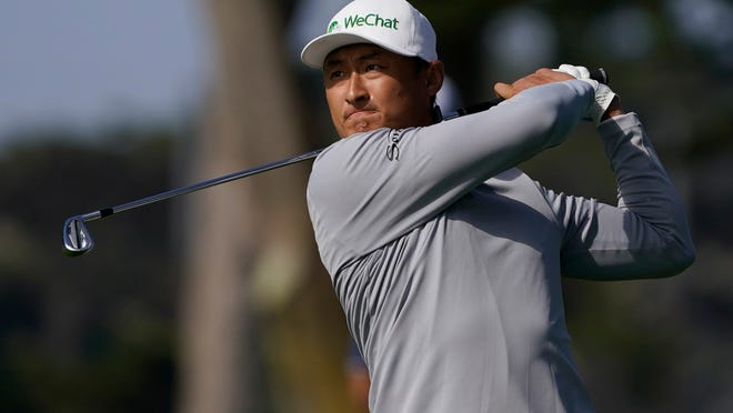 Li Haotong hits from the fairway on the 10th hole during the second round of the PGA Championship.
