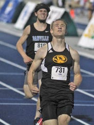 Bellevue senior Seth Evers wins the 200 during the