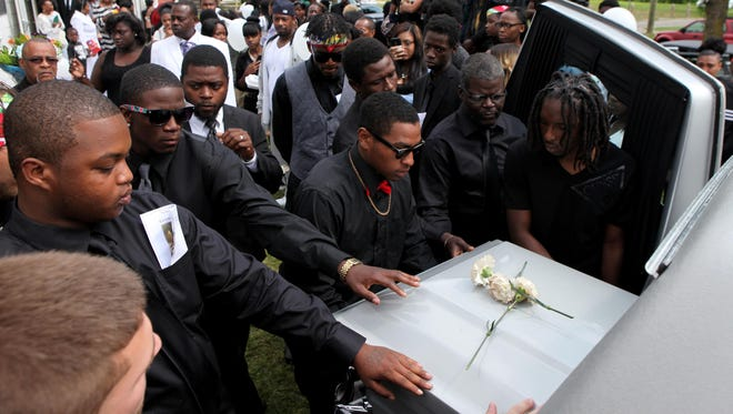 Pallbearers carry the casket of Raekwon Manigault after a service celebrating his life at Power House Church of God in Christ in Rochester.