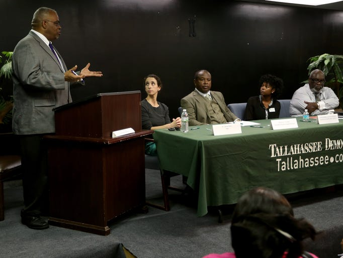 Moderator Byron Dobson asks a question of the panelists, from left to right, Dr. Tanya Evers of TMH, Pastor E.L. Franklin from Friendship Primitive Baptist Church, Kristy Goldwire, Executive Director of the Capital Area Healthy Start Coalition and Dr. Esaias Lee of Neighborhood Medical Center. The Tallahassee Democrat hosted the Healthy Babies forum on Tuesday at the Southside Arts Complex.