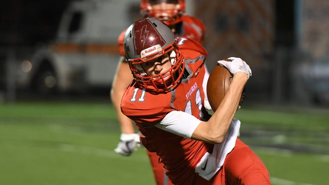 SJCC's Tad Foster caught two touchdown passes Friday against Tiffin Calvert.
