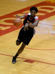 Richmond High School boys basketball player Adrion Gibson passes the ball during practice Wednesday, Nov. 18, 2015 in the Tiernan Center.