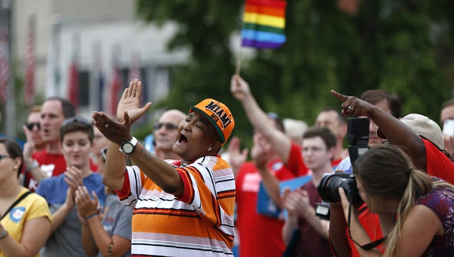 Corey Smith of Mount Healthy joins hundreds of others along with the group Why Marriage Matters Ohio at a rally for gay marriage in Lytle Park in August. The Enquirer/Jeff Swinger
