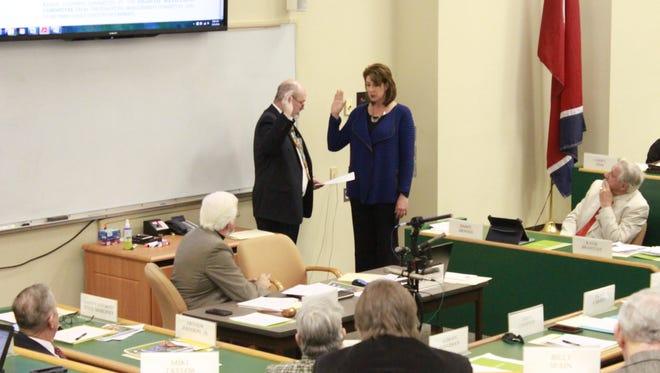 Angie Byers is sworn in as Madison County register of deeds Monday at a meeting of the Madison County Commission.