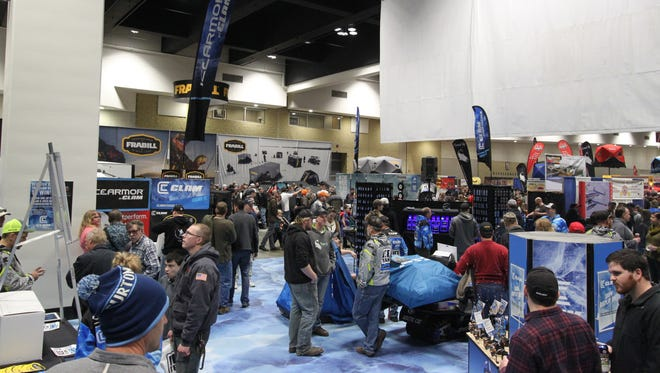 The St. Paul Ice Fishing Show was held last weekend. In its 24th year, the show has watched technology and interest in ice fishing grow greatly. Pictured are attendees making the rounds on Saturday, Dec. 3, checking out new lures, rods, and houses.