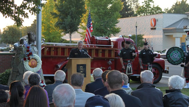 Keizer Fire Chief Jeff Cowan speaks during the annual 9/11 remembrance ceremony on Monday, Sept. 11, 2017.