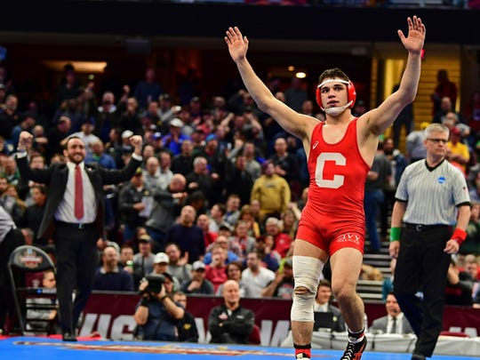 Cornell's Yanni Diakomihalis celebrates after defeating