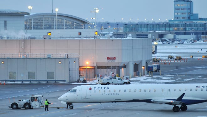 By early Friday, the airport had 113 canceled and 2 delayed arrivals, according to FlightStats.com. The storm warning lasts until 12 a.m. Saturday.