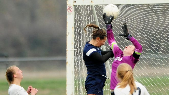 Cascade's goalkeeper has the ball go over hear hand and into the goal on a Brookings-Harbor free kick during the OSAA Class 4A state playoffs.