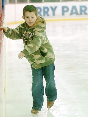 Eli Bunch, 8, got a little help from the boards as he made his way around the ice during open skating at the Perry Park Ice Rink. Bunch was visiting the rink with his family from Camby in January 2008.
