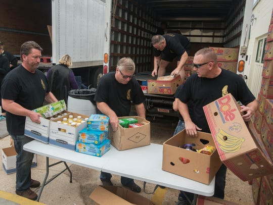 Krewe of Sparta members collect donated food Sunday,
