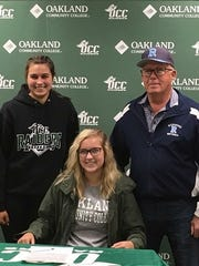Richmond High School senior Evelyn Swantek signs her letter of intent to play softball at Oakland Community College. She is joined by her high school coach Howard Stuart, and her sister Ally Swantek.