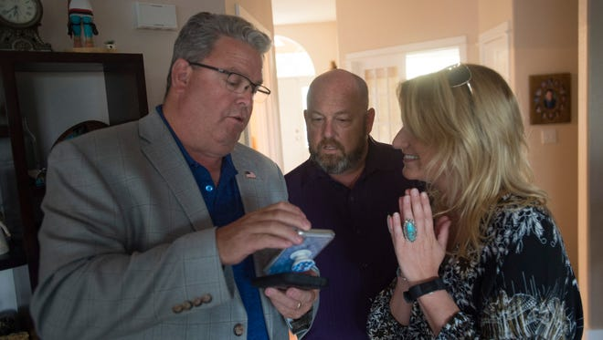 Sean Dougherty takes a look at early results with Jeff Jensen and Mackenzie Davin during a watch party at Dougherty's home in west Fort Collins on Election Day, Tuesday, June 26, 2018. Dougherty took an early lead in the GOP primary for Larimer County Commissioner with 58 percent of the vote.