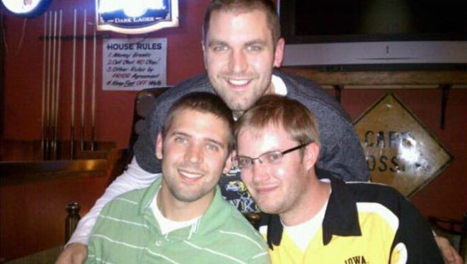 Jonathan Wieseler, right, is shown with his friends Adam Santi and Jason Moore in this contributed photo. Wieseler was killed on Sunday.