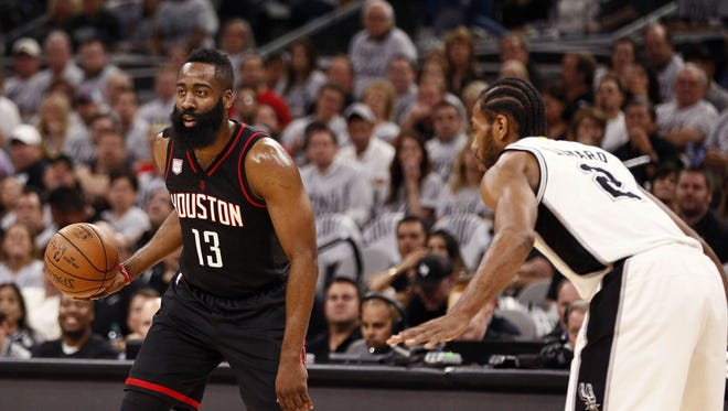 Houston Rockets shooting guard James Harden (13) dribbles the ball as San Antonio Spurs small forward Kawhi Leonard (2) defends during the first half in game one of the second round of the 2017 NBA Playoffs.