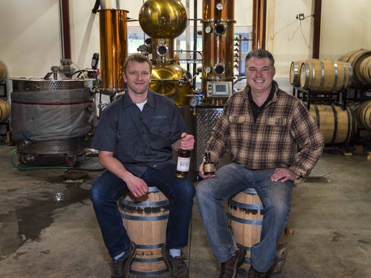 Al Hilton of Mad River Distillers in Warren, left,