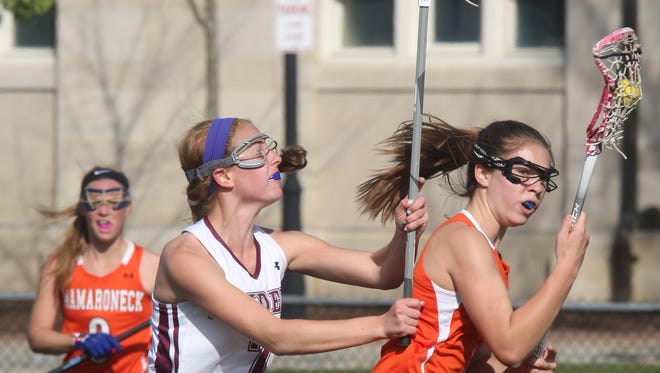 Scarsdale's Eliza Brosgol (7) guards Mamaroneck's Leah Holmes (1) during girls lacrosse game at Scarsdale High School on April 27, 2016. Mamaroneck defeats Scarsdale 9-7.