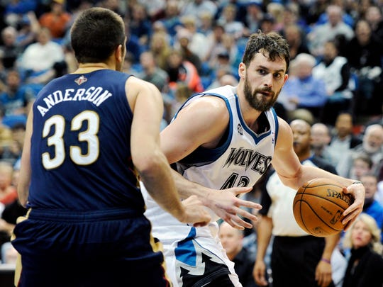 New Orleans Pelicans' Ryan Anderson (33) guards against Minnesota Timberwolves' Kevin Love (42) during the third quarter of an NBA basketball game on Wednesday, Jan. 1, 2014, in Minneapolis.