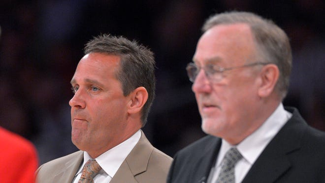 In this Feb. 28, 2013 photo, Minnesota Timberwolves assistant coach Bill Bayno, left,  looks on along with head coach Rick Adelman during the first half of their NBA basketball game against the Los Angeles Lakers in Los Angeles.