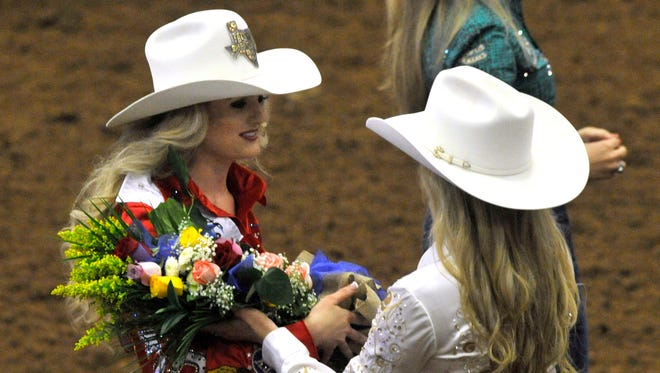 Abby Suggs, the 2017 Texas High School Rodeo Association Queen, is given a bouquet by the 2016 queen Bailey-Grace Snyder Sunday June 4, 2017 at the Taylor County Expo Center.