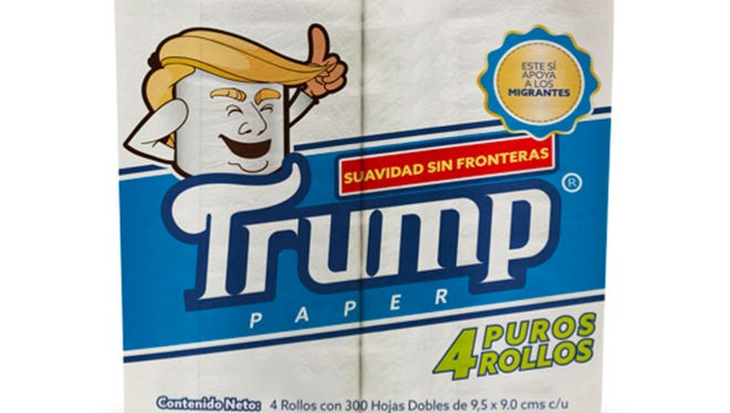 "This illustration released by Antonio Battaglia shows toilet paper wrapped in mock-up packaging, featuring a cartoon image in the likeness of President Donald Trump, with the Spanish phrases ""Softness without borders,"" center, ""This supports migrants,"" top right, ""Four pure rolls,"" bottom right, which is a play on words in Spanish that roughly translates as ""Pure nonsense."""
