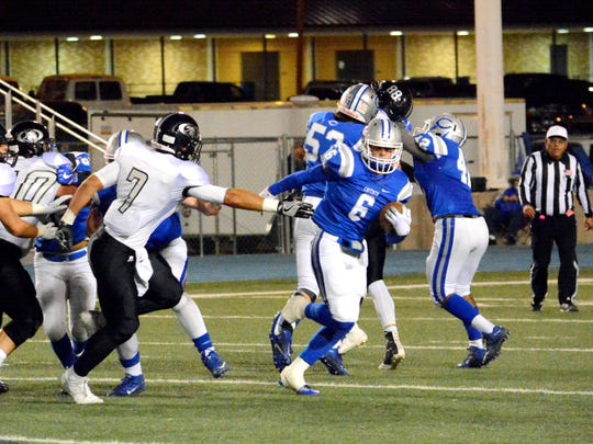 Carlsbad's Jaykan Willis finds an open gap in the first quarter Friday.